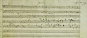 Первая страница партитуры. В верхнем правом углу надпись Моцарта  - 1792 -  предполагаемая дата окончания Реквиема_.